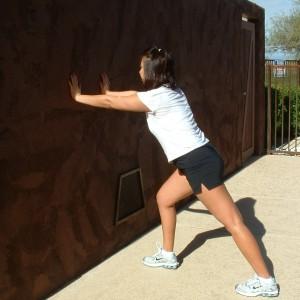 STANDING CALF AND WRIST STRETCH